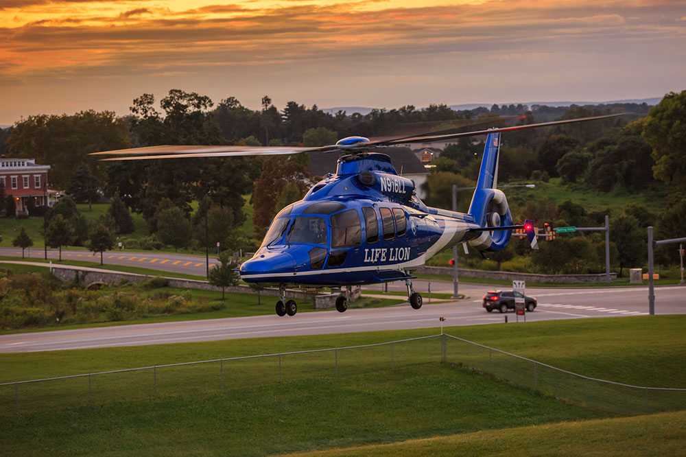 The Life Lion EMS helicopter is pictured at sunset as it prepares to land at Penn State Health Milton S. Hershey Medical Center.