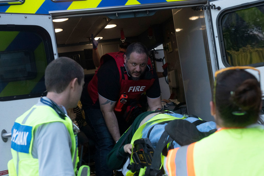 Penn State Health Milton S. Hershey Medical Center's Emergency Department participates in a full-scale exercise on Thursday, Sept. 19, 2019. Pictured is a man loading a stretcher into an ambulance.