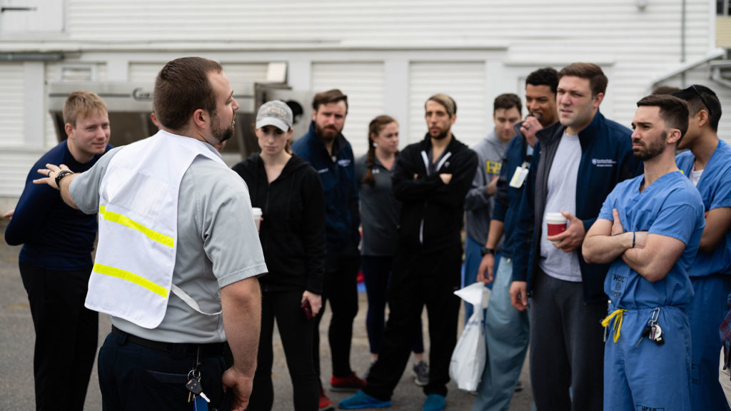 Joshua Knapp, a 2019 graduate of the Emergency Medical Services Fellowship, is pictured instructing a group of residents in 2019.